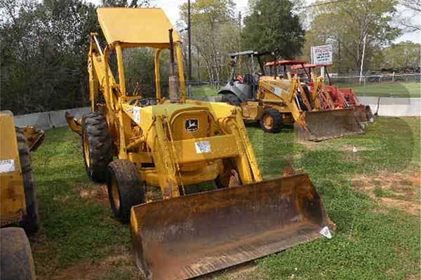 AMS Construction Parts - John Deere 300B Backhoe Attachments
